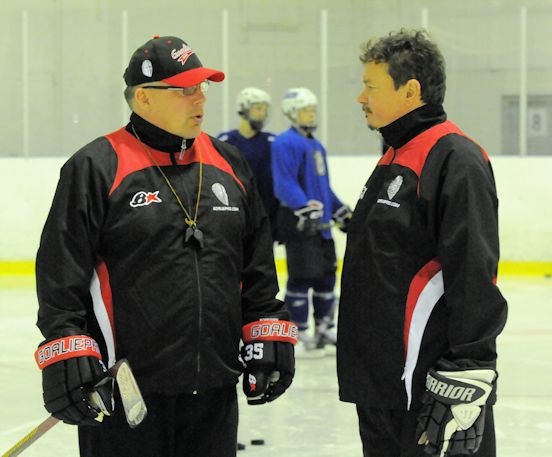 Ted Monnich (right) on the ice at 2014 GoaliePro camp discussing with Jukka Ropponen